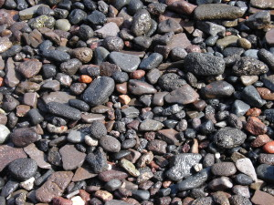 Gravel_on_a_beach_in_Thirasia,_Santorini,_Greece