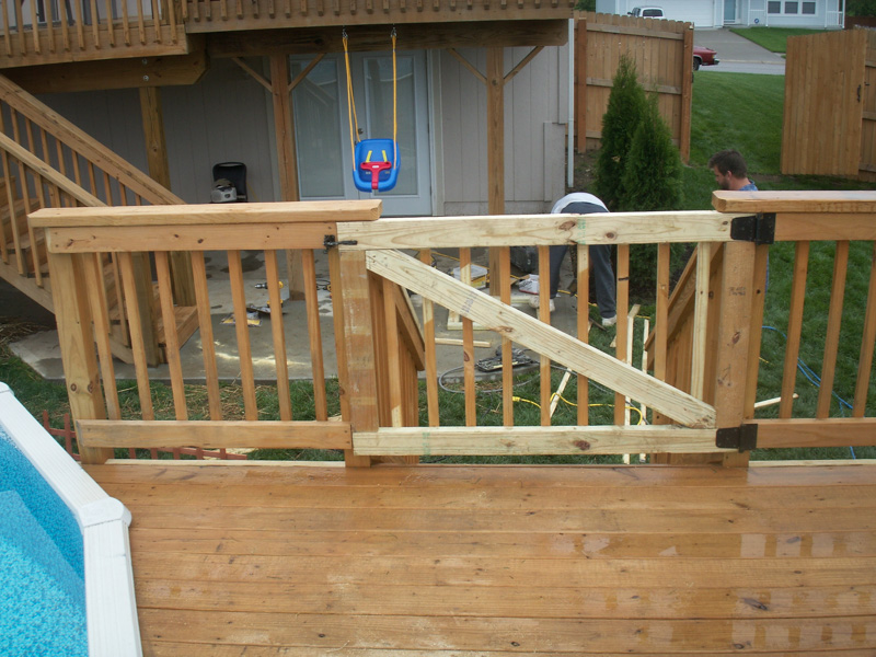 Treated deck built around existing pool belton mo deck for Best pool builders in kansas city