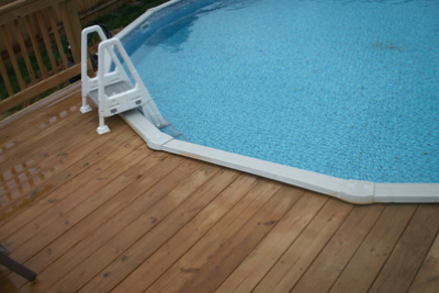 Treated Deck built around existing pool